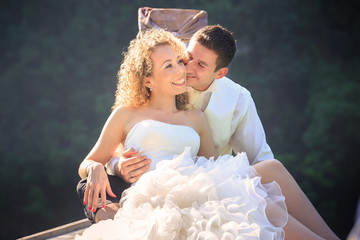 blonde bride and handsome groom on boat