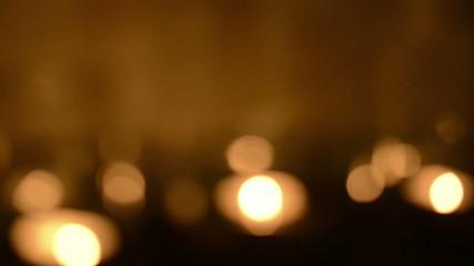 Bokeh blur defocused background of tea light candles glittering
