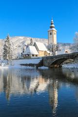 Church of St. John the Baptist by the Bohinj lake at winter