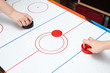 canvas print picture - Playing on air hockey