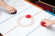 Playing on air hockey - 77856827