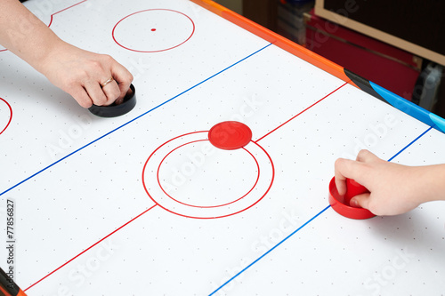 canvas print picture Playing on air hockey