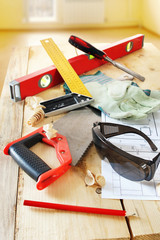 Composition with carpenter work tools on the wooden workbench