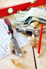 Composition with carpenter working tools on the wooden table
