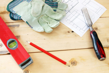 Composition with carpenter working tools on the wooden workbench