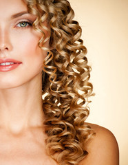 Young woman with gorgeous beautiful curly hair. Blond Hair.