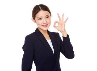 Businesswoman with ok sign