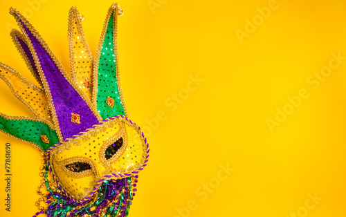 Fotobehang Carnaval Mardi Gras Mask on yellow Background