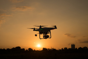 Silhouette Drone / quadcopter during sunrise or sunset