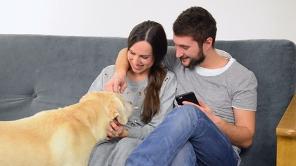 Couple spending time together with dog