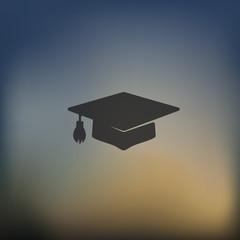 Graduation icon on blurred background