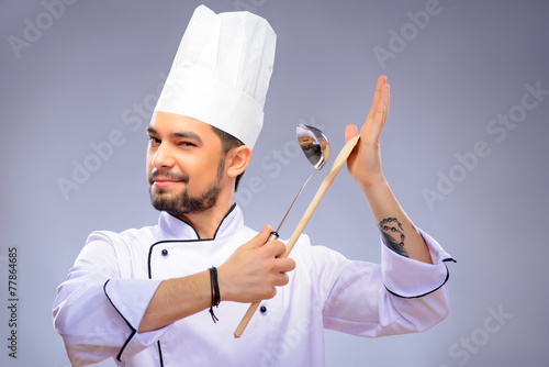 Portrait of young handsome cook - 77864685
