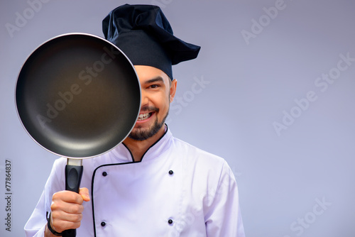 Portrait of young handsome cook - 77864837