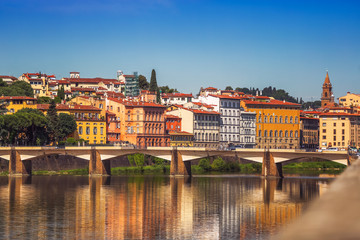 View of Ponte Vecchio with reflections in Arno River, Florence,