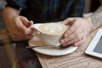 Dirty hands with cup of coffee
