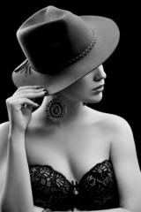 Portrait of beautiful sexy girl in black and white hat