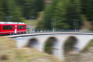 Red train in Alps, Switzerland.