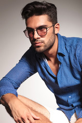 casual young fashion man on grey studio background