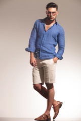 smart casual young man standing on studio background