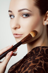young Girl with Makeup Brushes.