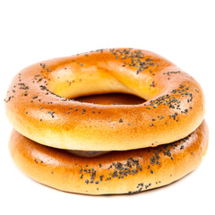 Bagel with poppy seeds on white background.