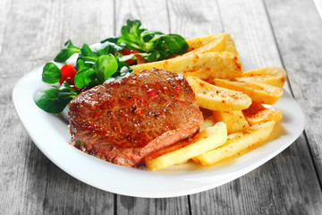 Flavored Grilled Meat with French Fries on Plate