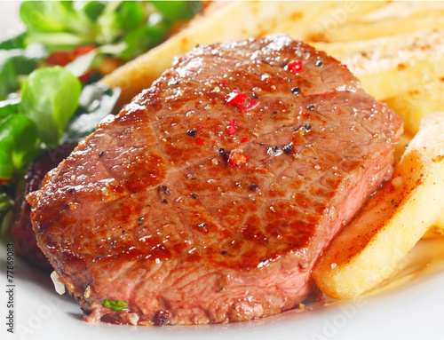 Juicy Grilled Beef on White Plate with Fries