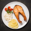 Grilled trout with vegetables and rice. Top view