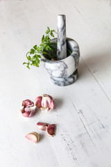 Garlic with marble mortar with parsley