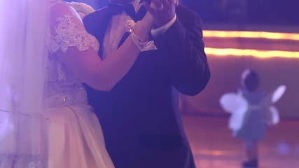 bride and groom dance at wedding party