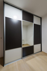 Wooden wardrobe with mirrors