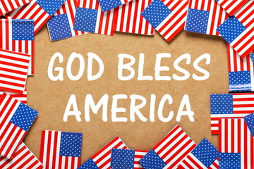 God Bless America text with flags of the United States