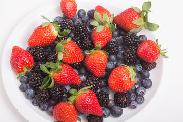 Strawberries Blackberries and Blueberries in White Plate
