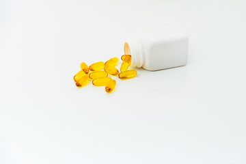 yellow medicine and white bottle