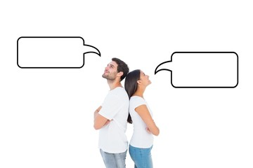 Composite image of happy couple standing looking up