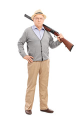 Senior gentleman posing with a rifle