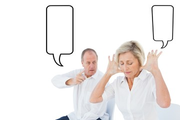 Composite image of older couple sitting in chairs arguing