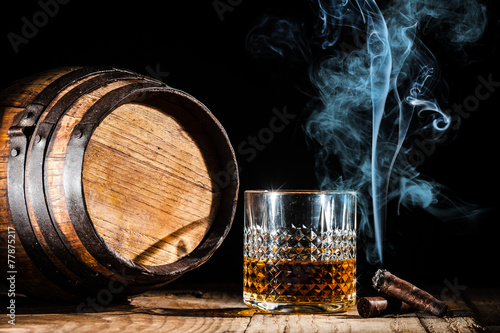 Aluminium Bar Glass of alcohol and smoking noble cigar on a black background
