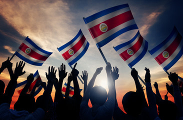Silhouettes People Holding Flag Costa Rica Concept