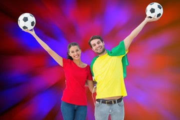 Football fan couple cheering and smiling at camera
