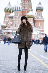 Young beautiful woman in stylish mink coat