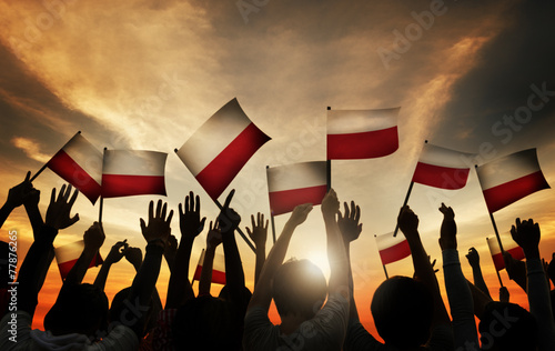 Obraz na płótnie Group People Waving Polish Flags Back Lit Concept