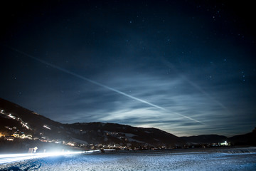 landscape of high Austrian Alps covered by snow at starry night
