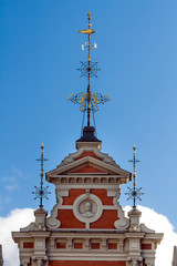 Golden spire on the tower of House of the Blackheads in Riga