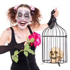 Frau mit Vogelkäfig, Rose und Totenkopf