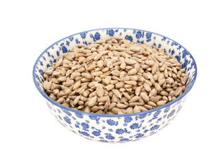 Sunflower seed hearts in a blue and white china bowl