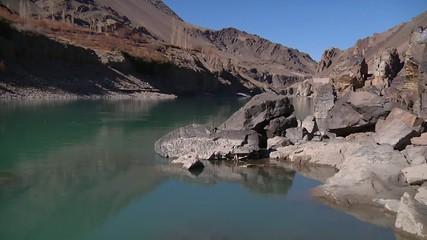 Mid shot rocky banks of Zanskar River in Ladakh, India