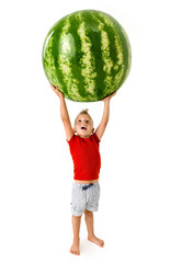 strong little boy lifting a big watermelon