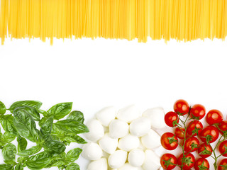 The Italian flag made up of fresh vegetables and spaghetti
