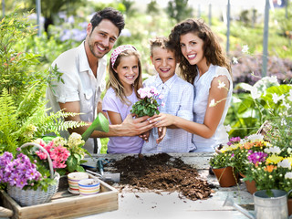 family have fun in the work  of gardening